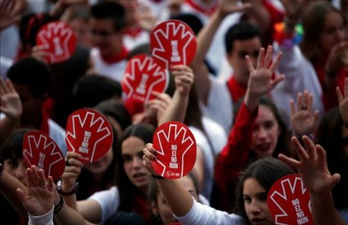 People take part in a protest against sexual violence against women during the San Fermin festival in Pamplona  northern Spain  July 11  2016  The red placards read  No  in several languages  REUTERS Susana Vera