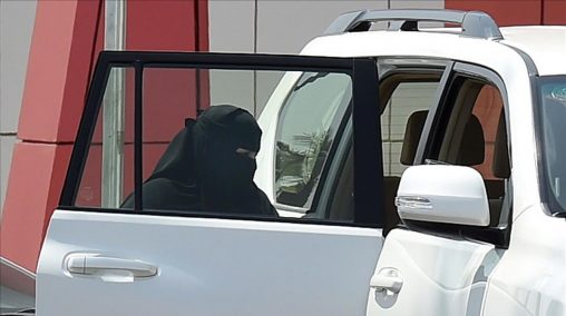 A Saudi woman rides into a car outside a mall in the Saudi capital Riyadh on September 27  2017  Saudi Arabia will allow women to drive from next June  state media said on September 26  2017 in a historic decision that makes the Gulf kingdom the last country in the world to permit women behind the wheel   The shock announcement comes after a years-long resistance from women s rights activists  some of whom were jailed for defying the ban on female driving    AFP PHOTO   FAYEZ NURELDINE
