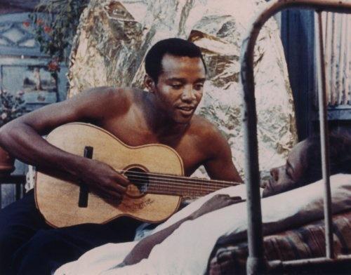 Orfeu tocant la guitarra